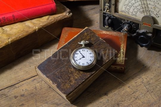 Pocket watch on old books and more various antiques
