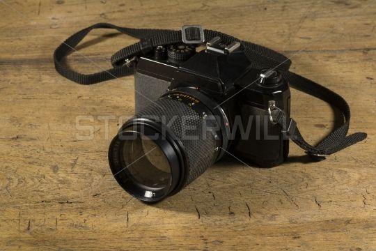 Old black retro style photo camera